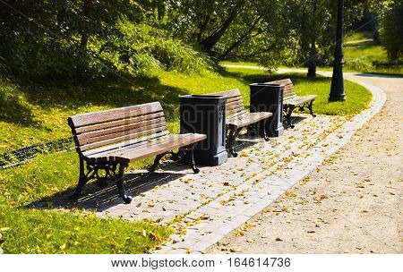 Benches with garbage urns in the city park