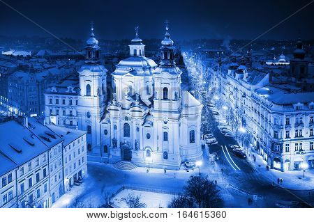 St. Nicholas' church. View of Old Town's Square in Prague in winter time blue colored
