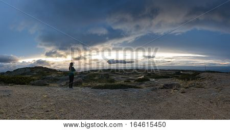 SERRA DA ESTRELA PORTUGAL - OCTOBER 18 2015: The young women looking at sunset in Serra da Estrela (