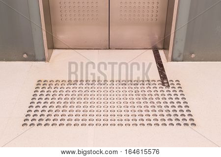 Tactile Paving Foot Path For The Blind Entrance Of Elevator