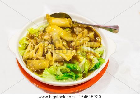 Chinese Delicacy Braised Fish Maw With Vegetable Served In Bowl