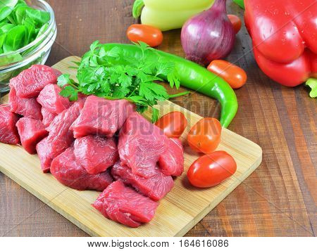 Cooking goulash with veal meat and vegetables.