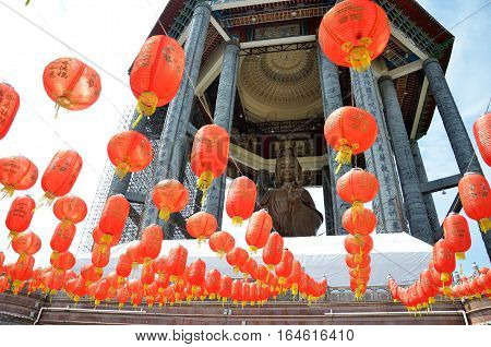 Guanyin And A Red Lanterns In Chinese Temple Penang, Malaysia