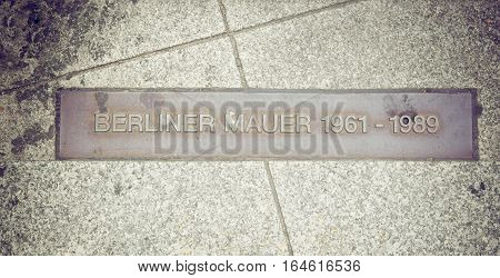 a memorial inscription in the place where the berlin wall was standing from 1961-1989 at potsdamer platz.