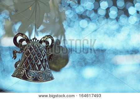 Christmas silver bell and ball ornament on artificial white tree
