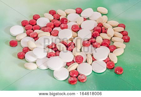 Red, White And Yellow Drugs Pills, Powder, Bunch, Medical, Homeopathic, Green Background, Close Up.