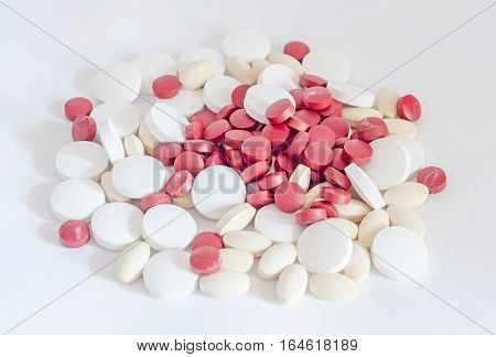 Red, White And Yellow Drugs Pills, Powder, Bunch, Medical, Homeopathic, White Background, Close Up.