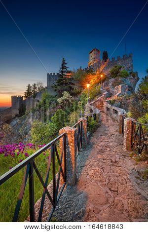 San Marino. Image of castle in San Marino during sunset.