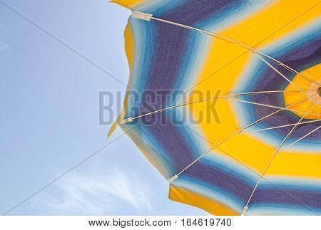 Colored Striped Sun Umbrella, Blue Sky, Outdoor, Half Close Up