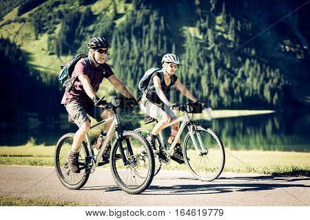 cycling seniors, by the vilsalpsee in austria