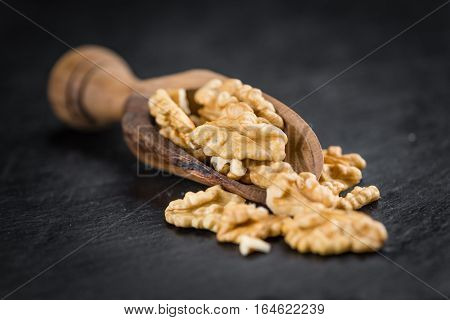 Rustic Slate Slab With Cracked Walnuts (selective Focus)
