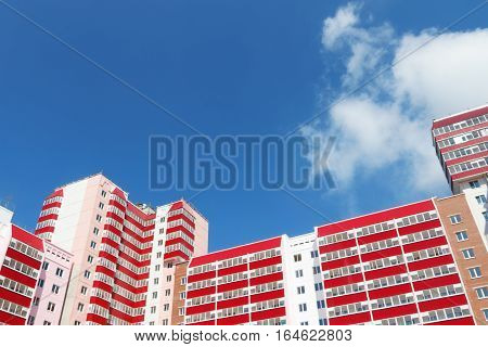 Part of residential building with balconies at sunny day clouds under view