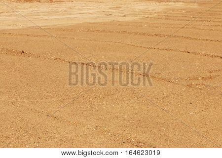 Yellow lined sand for asphalting on construction site at sunny day