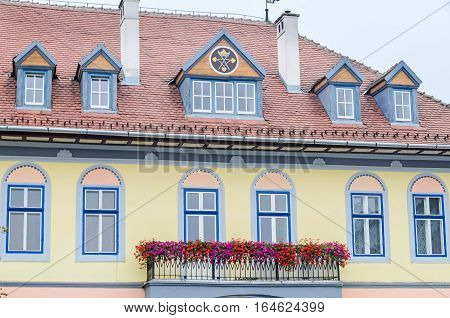Sibiu, Romania - August 10, 2016: Detail Of Houses Situated Near Downtown Of The City. Roof With Col
