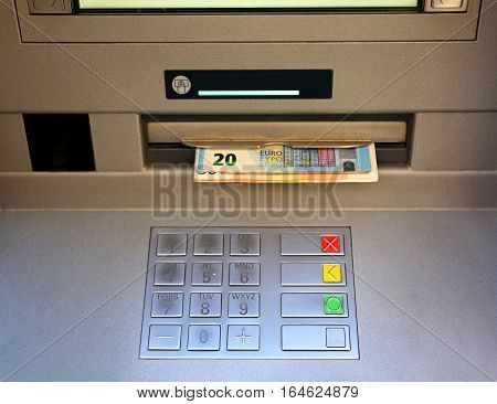 Keyboard Of An Atm With Money Coming Out