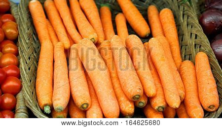 orange carrots in the basket at market