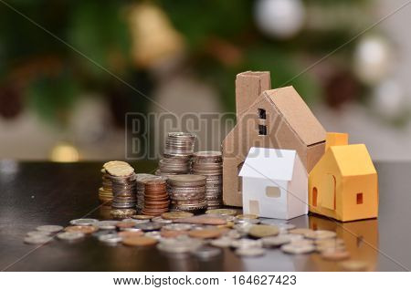 Paper House And Stacks Of Coins Standing