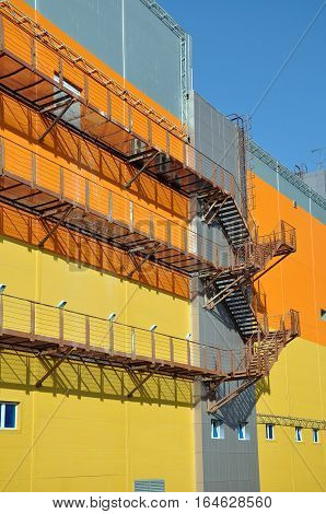 Fire Escape on the wall of an industrial building.