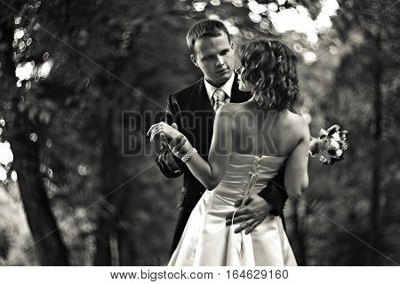 Shall We Dance? - Groom Leads A Bride To Dance In A Park