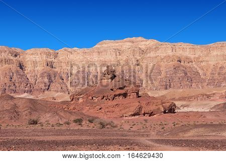 Timna park - Mount Screw with desert mountains and blue sky in the background