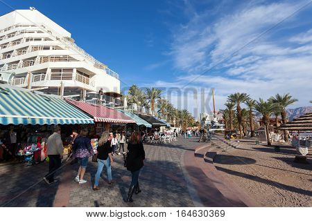 Eilat, Israel - January 4, 2017: Eilat's seaside boardwalk, known for it's Marina, shops, luxury hotels and restaurants.
