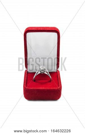Diamond ring in red jewel box on white background