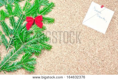 Red bow, fir tree and Dear Santa note