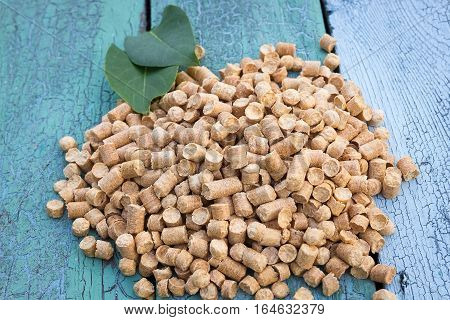 Wood pellets in the wooden background. Biofuels. Cat litter.