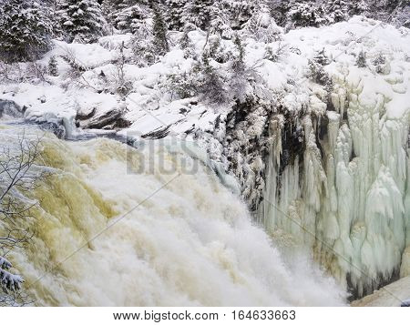 Tannoforsen waterfall in Sweden, does not freeze in the winter the water falls from a height of between stones