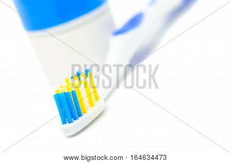 Toothbrush with colored bristles on a white background