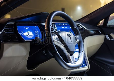 LJUBLJANA SLOVENIA - October 13 2016: The interior of a Tesla Model S electric car with steering wheel and dashboard at night