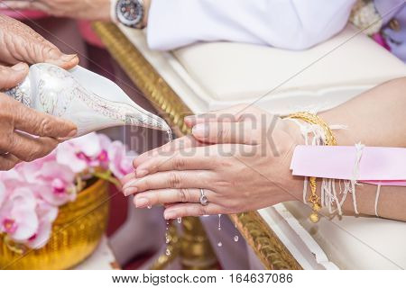 old people use conch shell wedding in wedding ceremony thailand