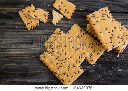 Crackers with sesame seeds on a wooden table in rustic style