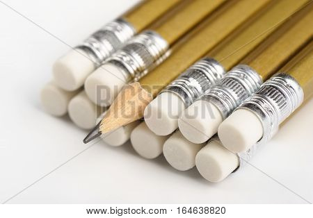 Graphite pencils close-up on a white background, shallow DOF