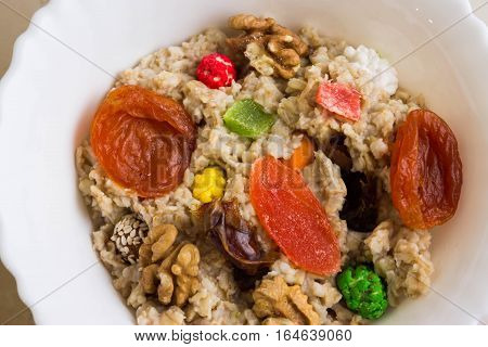 Oatmeal with dried fruit and nuts. Dietary food.