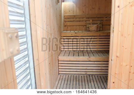Interior wooden sauna room and pillows, empty sauna