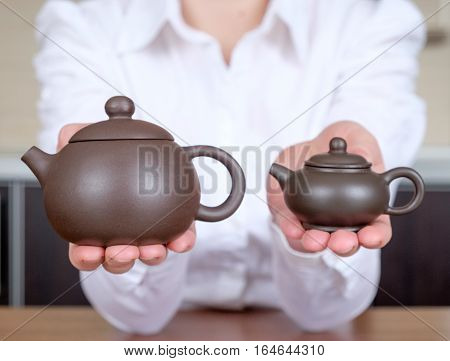Teapots In Her Hands