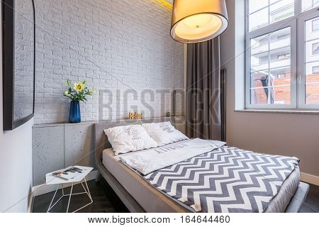 Bedroom With Window And Bed