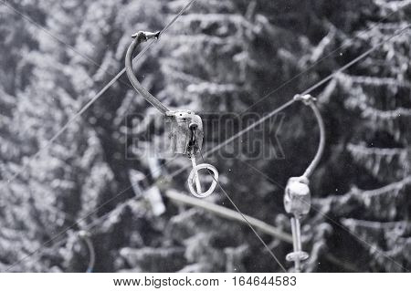 Empty ski lift cable in a ski resort during snowfall