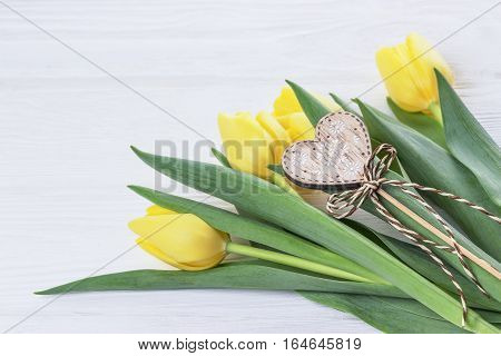 Happy Valentine's Day. Yellow tulips and heart