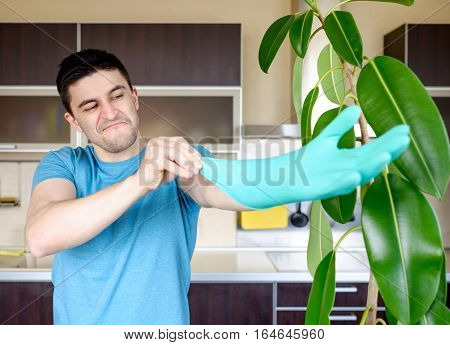 Man Putting On Rubber Gloves