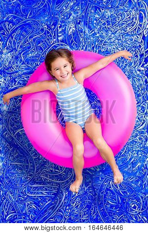 Happy Young Girl Floating In A Summer Pool