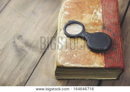 reading glass on the old book table