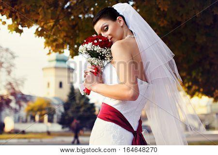 Bride Looks Misterious Holding A Wedding Bouquet