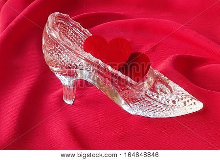 Two red hearts are in crystal shoe