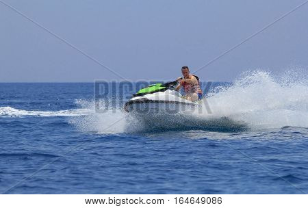 Young man having fun on a jet-ski