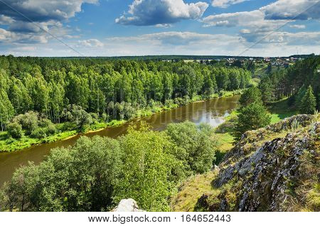 A beautiful rural landscape. Russia. Ural. In the distance the village of Kamenka