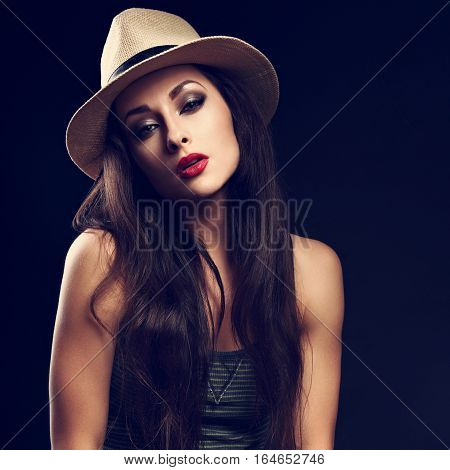 Beautiful Sexy Female Model With Long Brown Hair Posing In Cowboy Summer Hat And Fashion Top On Dark