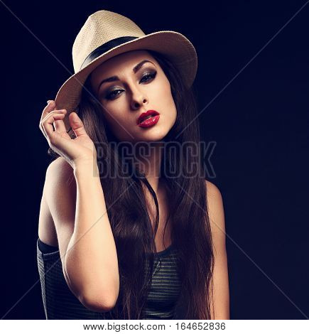 Beautiful Cool Female Model With Long Hair Posing In Cowboy Summer Hat And Fashion Top On Dark Backg