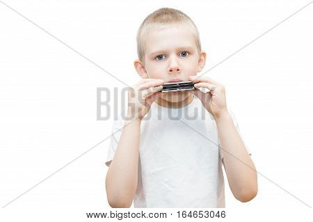 The photo depicts a boy with a harmonica